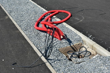 Repair of communications. cable outlet in corrugated red caviar for lamppost in the park