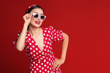 Portrait of a funny emotional young woman. Pin-up style.