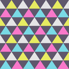 Abstract seamless pattern of color triangles.