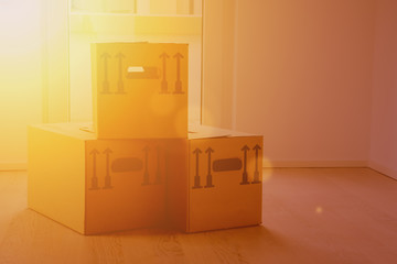 Moving boxes in golden sunny light