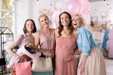 Successful women. Company of four beautiful successful women making photo during baby shower