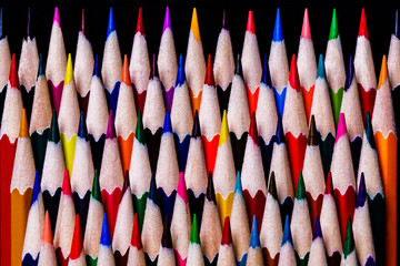 Colored Pencils stacked in a pattern but in a very OCD fashion ready for use by students or artists.  A Macro image with room for copy at the bottom of the image