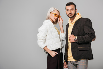 couple of models in autumn jackets posing isolated on grey background Wall mural