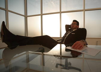 successful businessman relaxing at the table
