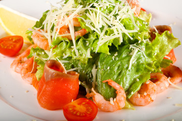 Caesar salad with shrimps and salmon