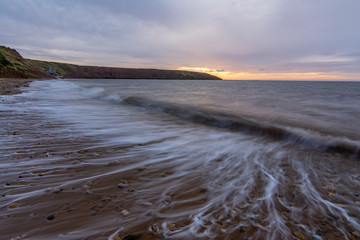 Filey seascape with wave trails, slow shutter to show the waves movement.