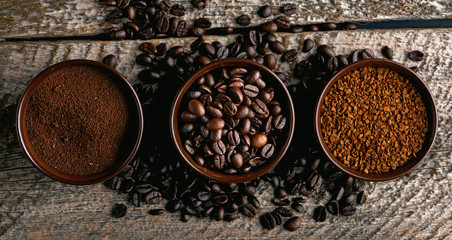 Coffee assortment. Closeup of three coffee types in cups on rustic wooden table.
