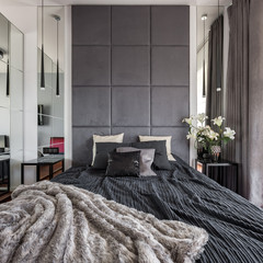 Luxurious bedroom with upholstered wall