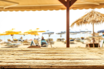 Fototapete - desk of free space and summer bar on beach.