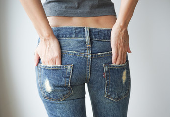 Woman wearing of jean pants, behind, Health concept.