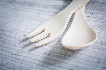 Crossed Set Of Bamboo Fork And Spoon In Children Size, Learn To Use Cutlery As A Child Concept