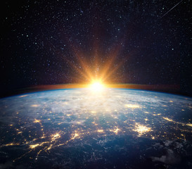 Wall Mural - Earth, sun, star and galaxy. Sunrise over planet Earth, view from space. Elements of this image furnished by NASA
