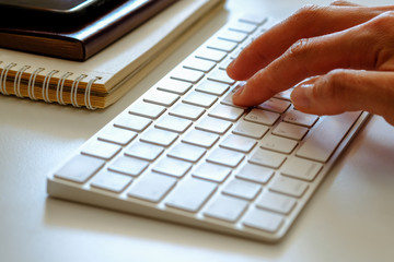 Female hand typing on the keyboard