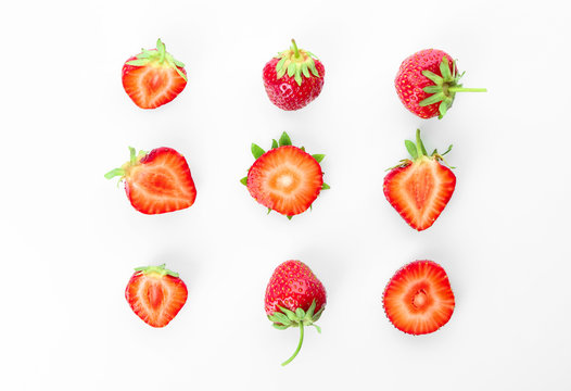 Flat lay composition with ripe strawberries on white background