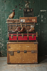 Stacked travel trunks and suitcases