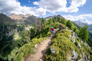 Woman Mountain Biking near Mont Blanc, Aosta Valley, Italy