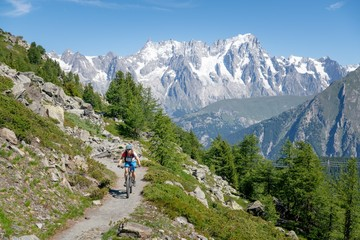 Woman Mountain Biking near Mont Blanc, Aosta Valley, Italy