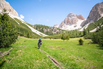 Woman mountain biking in Dolomites, Fanes-Sennes-Braies National Park, Italy