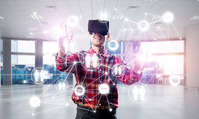 Guy wearing checked shirt and virtual mask reaching hand to touch screen