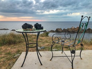 Two cameras on a table by the sea, Bulgaria