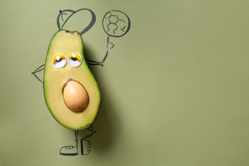 Funny avocado on color background