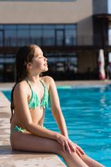 Teenage girl posing near pool