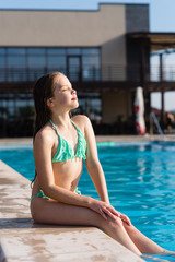 Attractive girl near swimming pool