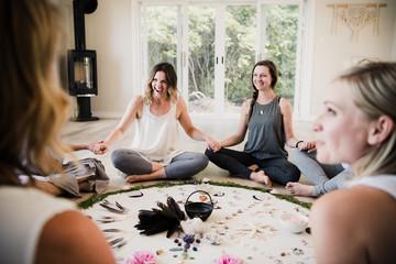 Women around circle in yoga retreat