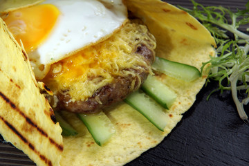 Egg tortilla with juicy beef patio, salad and pita bread, grilled