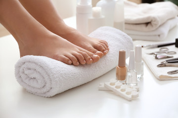 Wall Murals Pedicure Young woman after getting professional pedicure in beauty salon, closeup