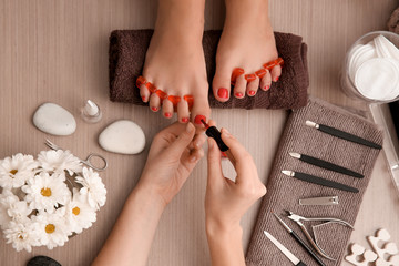 Aluminium Prints Pedicure Young woman getting professional pedicure in beauty salon