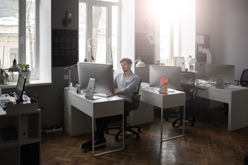 A man working in a modern design office