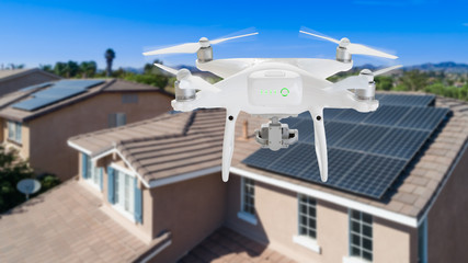UAV Drone Inspecting Solar Panels On Large House Wall mural
