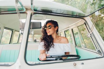 Woman driving retro car