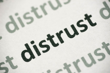 word distrust printed on paper macro