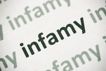 word infamy printed on paper macro
