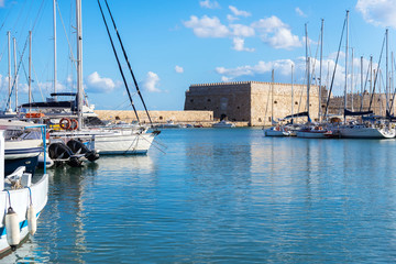 boats and yachts in old Venetian Harbour in summer sunny day, He
