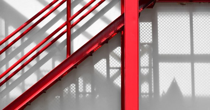 red fire escape staircase with shadow