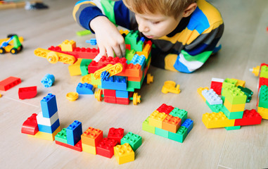 kid play with plastic blocks building constructing