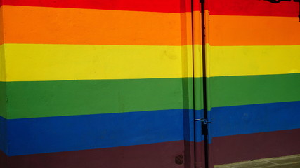Rainbow-painted wall symbol of the LGBT community in a public park in the city. conceptual image peace, tolerance