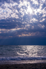 Amazing sea sunset, the sun, waves, clouds