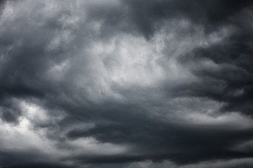 Artistic black and white dangerous stormy cloudy sky background.