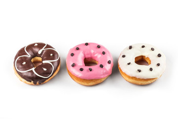 Colorful glazed donuts, top view over white background, isolated