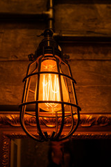 Vintage light bulbs with glower filament. Old fashioned lantern. Incandescent lamp, retro design.