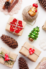 Christmas and New Year background with handmade presents wrapped in craft paper and decorations, holiday symbols.