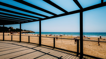Vacationers in Arrabassada Beach, one of the famous golden sand beaches in the Spanish Costa Daurada