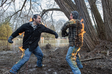 Stunt Men light themselves on fire and fight in their backyard