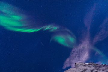 The polar arctic Northern lights aurora borealis sky star in Norway Svalbard in Longyearbyen city  mountains