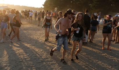 Revelers take part in the 24th Pol'and'Rock Festival (former Woodstock) in Kostrzyn upon Odra