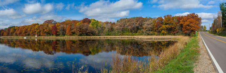 autumn lake and roadway, washington county, mn